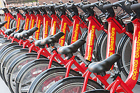 Red Capital Bikeshare rental bicycles in their bike docks on the streets of Washington DC.