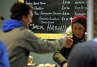 Pictured: People get served food and hot drinks Tuesday 29 November 2016<br />Re: Soup kitchen for homeless people organised by Swansea City FC and Woolwich at the Liberty Stadium, Wales, UK