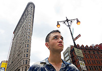 A young man near the Flatiron Building in New York City.