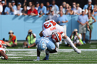 CHAPEL HILL, NC - SEPTEMBER 28: Dyami Brown #2 of the University of North Carolina is tackled by Chad Smith #43 of Clemson University during a game between Clemson University and University of North Carolina at Kenan Memorial Stadium on September 28, 2019 in Chapel Hill, North Carolina.