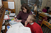 MR / Schenectady, New York.Mother goes over son's math assignment with him. Boy: 9..MR:Tro8, Tro5.© Ellen B. Senisi