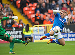 Dundee United v St Johnstone...24.08.13      SPFL<br /> Stevie May charges down Radoslaw Cierzniak<br /> Picture by Graeme Hart.<br /> Copyright Perthshire Picture Agency<br /> Tel: 01738 623350  Mobile: 07990 594431