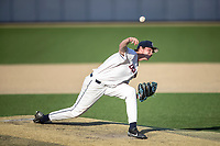 Connecticut Huskies pitcher Austin Peterson (49) delivers a pitch to the plate during the NCAA tournament against the Michigan Wolverines on June 4, 2021 at Frank Eck Stadium in Notre Dame, Indiana. The Huskies defeated the Wolverines 6-1. (Andrew Woolley/Four Seam Images)