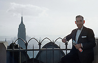 Mid-adult man standing by railing, NY