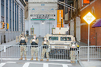 Massachusetts National Guard Military Police stand with a Humvee outside the Orpheum Theatre on Tremont Street in Boston, Massachusetts, on Sun., June 7, 2020. After isolated attacks on businesses earlier in the week and small clashes with police, Massachusetts and other states activated National Guard units to provide security as nationwide demonstrations against police brutality continue in the weeks after George Floyd was killed by police in Minneapolis on May 25, 2020.