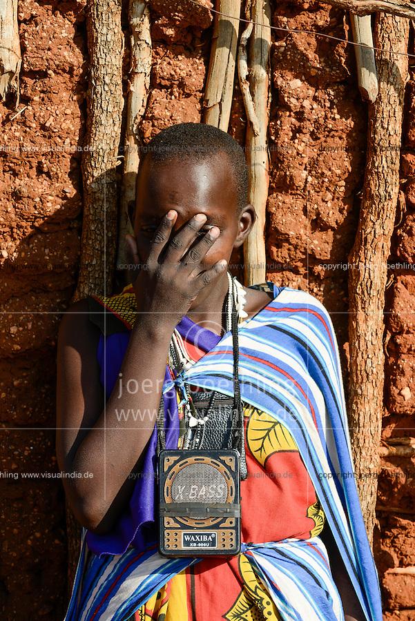 TANZANIA, Korogwe, Massai in Kwalukonge village, woman with chinese radio X-BASS / TANSANIA, Korogwe, Massai im Dorf Kwalukonge, Frau mit chinesischem Radio X-BASS