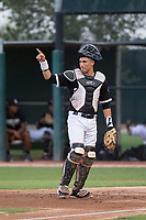 AZL White Sox catcher Ty Greene (26) signals to the defense during an Arizona League game against the AZL Diamondbacks at Camelback Ranch on July 12, 2018 in Glendale, Arizona. The AZL Diamondbacks defeated the AZL White Sox 5-1. (Zachary Lucy/Four Seam Images)