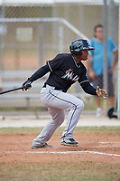 Miami Marlins Yefry Reyes (3) follows through on a swing during a minor league Spring Training game against the New York Mets on March 26, 2017 at the Roger Dean Stadium Complex in Jupiter, Florida.  (Mike Janes/Four Seam Images)