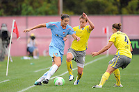 Yael Averbuch (13) of Sky Blue FC is marked by Joanna Lohman (17) and Jen Buczkowski (4) of the Philadelphia Independence  during a Women's Professional Soccer (WPS) match at Yurcak Field in Piscataway, NJ, on August 22, 2010.