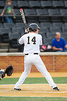 Conor Keniry (14) of the Wake Forest Demon Deacons at bat against the Maryland Terrapins at Wake Forest Baseball Park on April 4, 2014 in Winston-Salem, North Carolina.  The Demon Deacons defeated the Terrapins 6-4.  (Brian Westerholt/Four Seam Images)