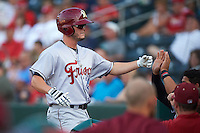 Frisco RoughRiders first baseman Trever Adams (29) congratulated by teammates after hitting a home run during a game against the Springfield Cardinals  on June 4, 2015 at Hammons Field in Springfield, Missouri.  Frisco defeated Springfield 8-7.  (Mike Janes/Four Seam Images)