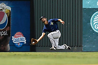 Center fielder Gene Cone (9) of the Columbia Fireflies catches a fly ball during a game against the Greenville Drive on Tuesday, August 22, 2017, at Fluor Field at the West End in Greenville, South Carolina. Columbia won, 14-7. (Tom Priddy/Four Seam Images)