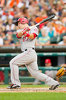 Mike Trout (27) of the Los Angeles Angels follows through on his swing against the Detroit Tigers at Comerica Park on June 25, 2013 in Detroit, Michigan.  The Angels defeated the Tigers 14-8.  (Brian Westerholt/Four Seam Images)