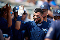 Mobile BayBears Julian Leon (20) high fives teammates after hitting a home run during a Southern League game against the Montgomery Biscuits on May 2, 2019 at Riverwalk Stadium in Montgomery, Alabama.  Mobile defeated Montgomery 3-1.  (Mike Janes/Four Seam Images)