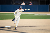 Michigan Wolverines designated hitter Ted Burton (3) points to the dugout after hitting a home run during the NCAA baseball tournament against the Connecticut Huskies on June 4, 2021 at Frank Eck Stadium in Notre Dame, Indiana. The Huskies defeated the Wolverines 6-1. (Andrew Woolley/Four Seam Images)