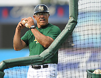 Manager Luis Salazar (4) of the Lynchburg Hillcats, Carolina League affiliate of the Atlanta Braves, throws batting practice prior to a game against the Wilmington Blue Rocks on June 15, 2011, at City Stadium in Lynchburg, Va. Salazar was struck in the left eye with a foul ball in Spring Training and has received an artificial eye. Photo by Tom Priddy / Four Seam Images