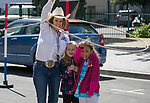 Laura Pierce teaches young girls rope tricks during the Reno Rodeo Parade on Saturday, June 22, 2019.