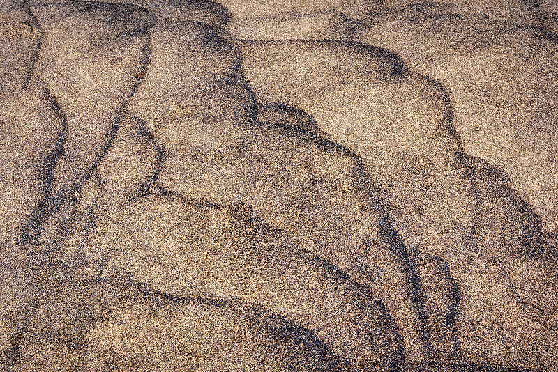 Wave sand patterns. . Honokohau Bay. Hawaii the big island