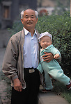Proud senior man holding child; portrait; expressions; family ties; heritage; Chongqing, China, Asia; 041603