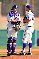 Catcher Josh Spano #21 of the High Point Panthers has a chat with pitcher Jacob Newberry #20 during the game against the Dayton Flyers at Willard Stadium on February 26, 2012 in High Point, North Carolina.    (Brian Westerholt / Four Seam Images)