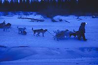 B Cotter Mushes Near Open Water Kuskokwim Rv Iditarod 99 AK Near Rohn Night