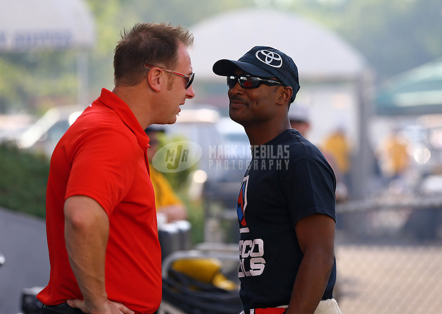 May 31, 2013; Englishtown, NJ, USA: NHRA top fuel dragster driver Antron Brown (right) during qualifying for the Summer Nationals at Raceway Park. Mandatory Credit: Mark J. Rebilas-