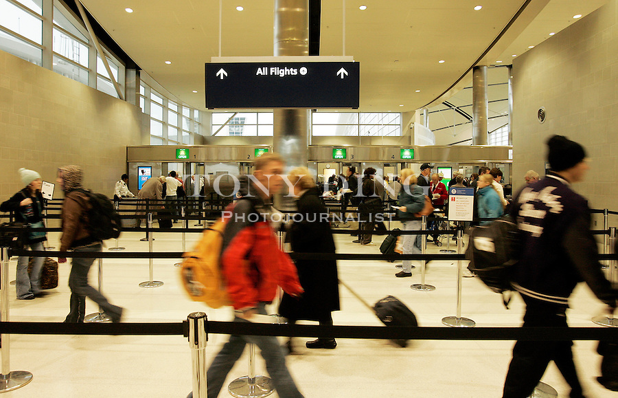 Passengers wind through an airport security checkpoint, on Wednesday, Nov. 24, 2005 at Detroit Metropolitan Airport. Airport officials say, so far, Thanksgiving air travelers have been lower in volume than previous years. (AP Photo/Tony Ding)