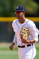 FCL Tigers West outfielder Carlos Pelegrin (33) jogs to the dugout during a game against the FCL Yankees on July 31, 2021 at Tigertown in Lakeland, Florida.  (Mike Janes/Four Seam Images)