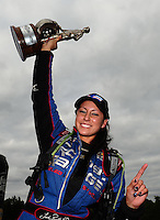 Sept. 18, 2011; Concord, NC, USA: NHRA pro mod driver Leah Pruett celebrates after winning the O'Reilly Auto Parts Nationals at zMax Dragway. Mandatory Credit: Mark J. Rebilas-