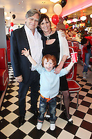 """NO REPRO FEE. 26/5/2011. NEW EDDIE ROCKET'S SHAKE SHOP. Des Fagan, Jessica Fortune and Robert Fortune are pictured in the new Eddie Rocket's Shake Shop. The design seeks to recall the vintage milkshake bars from 1950's America and re-imagine them for the 21st century. The new look aims to appeal to both young and old with a quirky and bold colour scheme and a concept of make-your-own milkshakes, based on the tag line """"You make it...We shake it!"""". Eddie Rocket's City Diner in the Stillorgan Shopping Centre in south Dublin has re-opened after an exciting re-vamp and the addition of a Shake Shop. Ten new jobs have been created with the Diner's re-launch bringing the total working in Eddie Rocket's Stillorgan to 30. Picture James Horan/Collins Photos"""