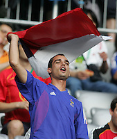 A French fan welcomes his team to the field.  France defeated Portugal, 1-0, in their FIFA World Cup semifinal match at FIFA World Cup Stadium in Munich, Germany, July 5, 2006.