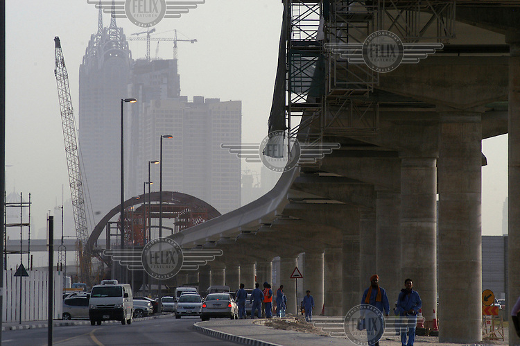 An urban railway line being built to connect Media City to other Dubai developments. In the background are two buildings that imitate the Chrysler Building.