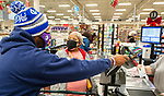 WATERBURY, CT-122220JS03- Customer Telicia Townsend of Waterbury is surprised when Kristopher Reese, Pastor at Grace Baptist Church in Waterbury, left, walked up and paid for her groceries Tuesday at the ShopRite of Waterbury. <br /> Jim Shannon Republican-American