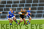 Mark O'Shea Dr Crokes  goes past  Sean Sheehan Templenoe during their  SFC clash in Fitzgerald Stadium on Friday evening