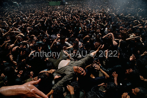 """Tehran, Iran .June 6, 1989..Mourners gather at the burial site for the funeral for the Grand Ayatullah Sayid Ruhullah Musawi Khomeini at the Beheht-E-Zahra cemetery. His body is flown in by helicopter to this site but frenzied crowds prevent the first attempt to bury him. Late in the day, after some of the crowds were cleared, he is buried at this site. He died of heart attack on June 3, 1989....Khomeini was a senior Muslim cleric, Islamic philosopher and marja (religious authority), and the political leader of the 1979 Iranian Revolution that saw the overthrow of Mohammad Reza Pahlavi, the last Shah of Iran. Following the revolution, Khomeini became the country's Supreme Leader?the paramount political figure of the new Islamic Republic...Khomeini was a marja al-taqlid, (source of imitation) and important spiritual leader to many Shia Muslims. He was also an innovative Islamic political theorist, most noted for his development of the theory of velayat-e faqih, the """"guardianship of the jurisconsult (clerical authority)"""". He was named Time's Man of the Year in 1979 and also one of Time magazine's 100 most influential people of the 20th century."""