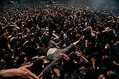 "Tehran, Iran .June 6, 1989..Mourners gather at the burial site for the funeral for the Grand Ayatullah Sayid Ruhullah Musawi Khomeini at the Beheht-E-Zahra cemetery. His body is flown in by helicopter to this site but frenzied crowds prevent the first attempt to bury him. Late in the day, after some of the crowds were cleared, he is buried at this site. He died of heart attack on June 3, 1989....Khomeini was a senior Muslim cleric, Islamic philosopher and marja (religious authority), and the political leader of the 1979 Iranian Revolution that saw the overthrow of Mohammad Reza Pahlavi, the last Shah of Iran. Following the revolution, Khomeini became the country's Supreme Leader?the paramount political figure of the new Islamic Republic...Khomeini was a marja al-taqlid, (source of imitation) and important spiritual leader to many Shia Muslims. He was also an innovative Islamic political theorist, most noted for his development of the theory of velayat-e faqih, the ""guardianship of the jurisconsult (clerical authority)"". He was named Time's Man of the Year in 1979 and also one of Time magazine's 100 most influential people of the 20th century."