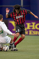 New England Revolution's Brian Kamler tackles the ball away from the MetroStars' Sergio Galvan Rey. The New England Revolution played the NY/NJ MetroStars to a 1 to 1 tie at Giant's Stadium, East Rutherford, NJ, on April 25, 2004.