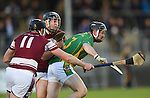 Alan Kilcoyne of Broadford in action against Alan O Neill and Brian Guilfoyle  of St Joseph's Doora Barefield during their Intermediate county final in Cusack Park. Photograph by John Kelly.