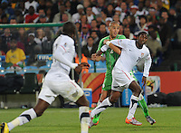 Algeria's Madjid Bougherra tries to hold back Edson Buddle's run towards goal. The United States won Group C of the 2010 FIFA World Cup in dramatic fashion, 1-0, over Algeria in Pretoria's Loftus Versfeld Stadium, Wednesday, June 23rd..