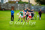 James O'Connor of Na Gaeil in possession as An Ghaeltacht's Colm O'Riagain and team mate Brian O'Beaglaoich tries to challenge him in the Intermediate Club Football Championship