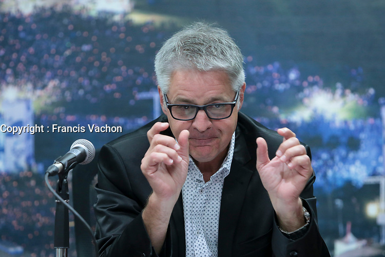 Daniel Gelinas gestures as he announce that he quits his job as Festival D'ete de Quebec (FEQ) General Manager in Quebec city Wednesday July 26, 2017.