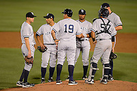 Tampa Yankees manager Luis Sojo #19 makes a pitching change as (L-R) Carmen Angelini #11, Ali Castillo #12, Angelo Gumbs #13, Matt Snyder #29 and Francisco Arcia #57 wait during a game against the Dunedin Blue Jays on April 11, 2013 at Florida Auto Exchange Stadium in Dunedin, Florida.  Dunedin defeated Tampa 3-2 in 11 innings.  (Mike Janes/Four Seam Images)