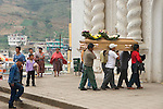 A group of Guatemalan men carry a casket into a church in the town of Zunil, Guatemala, in the Western Highlands