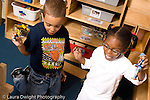 Preschool ages 3-5 boy and girl playing together in block area