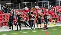WASHINGTON, DC - SEPTEMBER 12: Ben Olsen of D.C. United jokes with his staff during a game between New York Red Bulls and D.C. United at Audi Field on September 12, 2020 in Washington, DC.