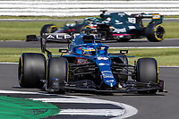 18th July 2021; Silverstone Circuit, Silverstone, Northamptonshire, England; Formula One British Grand Prix, Race Day; Alpine F1 Team driver Fernando Alonso in his Alpine A521 Renault E-Tech 20B ahead of Aston Martin Cognizant F1 Team driver Lance Stroll in his Aston Martin AMR21 Mercedes-AMG F1 M12