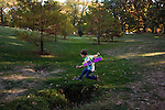 My older son, then age five, practices flying leaps with his Buzz Lightyear wings.