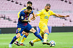 Lionel Andres Messi of FC Barcelona (L) in action against Oussama Tannane of UD Las Palmas (R) during the La Liga 2017-18 match between FC Barcelona and Las Palmas at Camp Nou on 01 October 2017 in Barcelona, Spain. (Photo by Vicens Gimenez / Power Sport Images