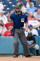 Home plate umpire Rob Healy asks for two baseballs at Harbor Park June 7, 2009 in Norfolk, Virginia. (Photo by Brian Westerholt / Four Seam Images)