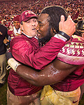 Florida State head coach Jimbo Fisher and running back Dalvin Cook celebrate a 31-13 victory over Florida after an NCAA college football game in Tallahassee, Fla., Saturday, Nov. 26, 2016. (AP Photo/Mark Wallheiser)